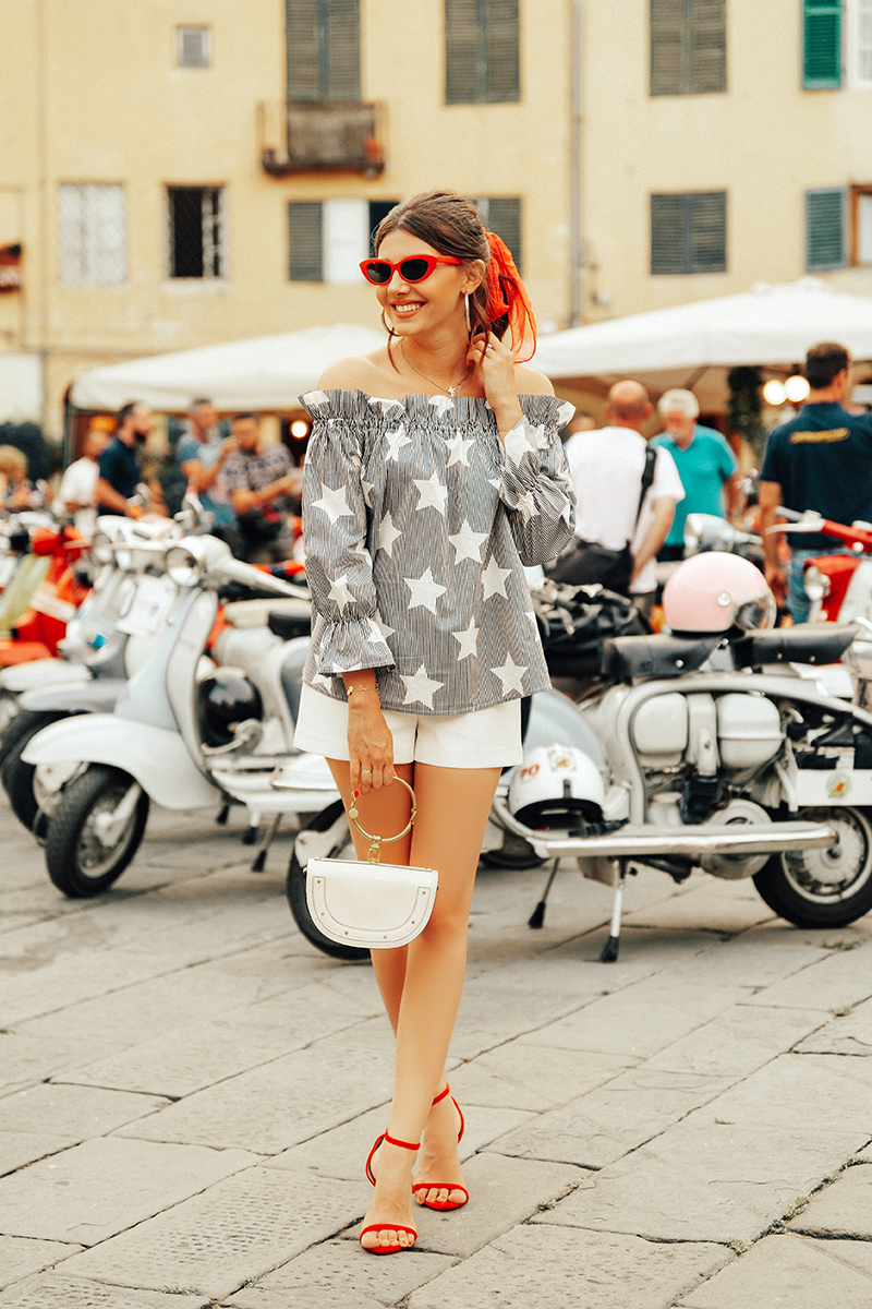 larisa costea, larisa costea blog, larisa style, larisa in italy, larisa in tuscany, tuscany, toscana, 2018, estate 2018, summer 2918, vanacanta, holiday, vacation, summer holiday,european summer, lucca, luca, festa, vespa, piazza anfiteatro, floers, bella italia, italian streets, italian bacony, red sandals, summer outfit, outfit inspiration, velvet sandals, raye the label, revolve, white shorts, asos, chciwish top, chic top, off the shoulder, strpes and stars, 4th of july outfit inspiration, red sunnies, asos sunnies, retro sunnies, red vintage scraf, chic look, girly look