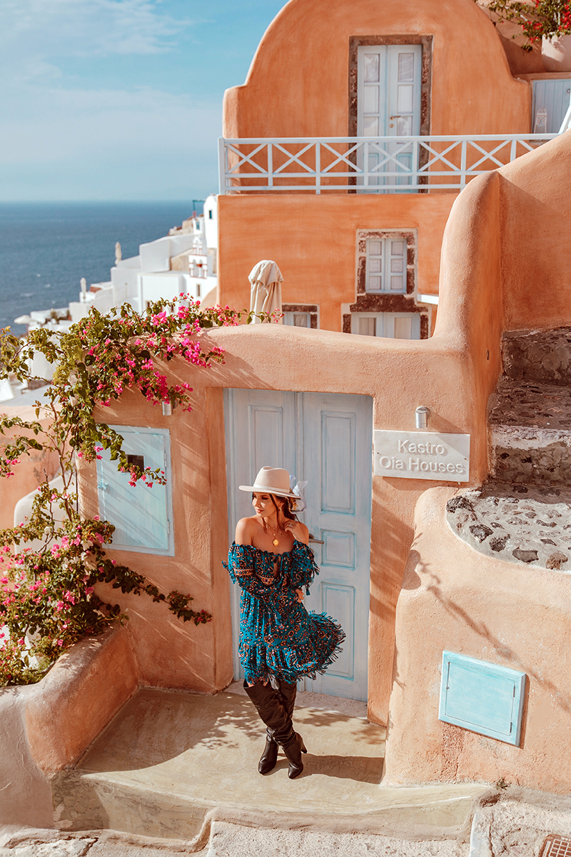 larisa costea,larisa costea blog,larisa costea style, larisa style, larisain greece,larisain santorini,santorini, greece,kiklades, oia, best view in oia, oia windmills,oia yellow building,oia orange house, castle view, ruin castlein oia, satorini, fashion blogger in satorini,travelblogger in satorini, travel blogger, fashion blogger, style blogger, what to wear in greece, greek island, best greek island, best destination, best vacation, besta look,bestalook, besta, missguided,missguided dress, blue boho gress, boho, gypsy, gyspsy style, boho chic,over the knee boots, black boots,knee high boots, fedora hat, club monaco hat, shopbop, chanel vintage coin, chanel ewelry, handmade by anca pop, gold necklaces, boho life, sunset in oia, caldera, caldera viewionic sea, october 2018, vacation, trip, adventure, best holiday trip, power couple, adrian sunrise inc, adrian mindroc, male blogger, men style, oia church, greek church, church bell,all white
