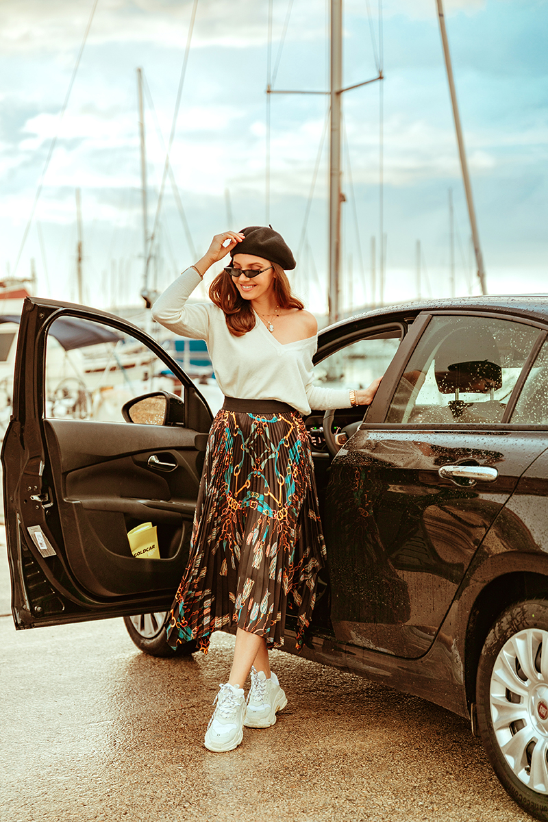 larisa costea,larisa costea blog,larisa in sardinia,larisa style,fall outfit,travel blog,traveler, best travel advice, sardinia, sardegna, gold card, alghero, gold car, rent a car, carrental,services, car rental, fiat typo, rental, black bag, big car, safe car, flooding in sardinia, keep safe, be safe, beret, black beret, asos, missguided sunglasses,mini sunglasses,micro sunglasses trend, black sunnies, zara skirt,pleated skirt,essica buurman sneakers, white sneakers,balenciaga sneakers, dupes,look alike, white sweater,blends of love, white sweater,white jumper, alghero, alghero port, car shooting, black car, rain,rainy