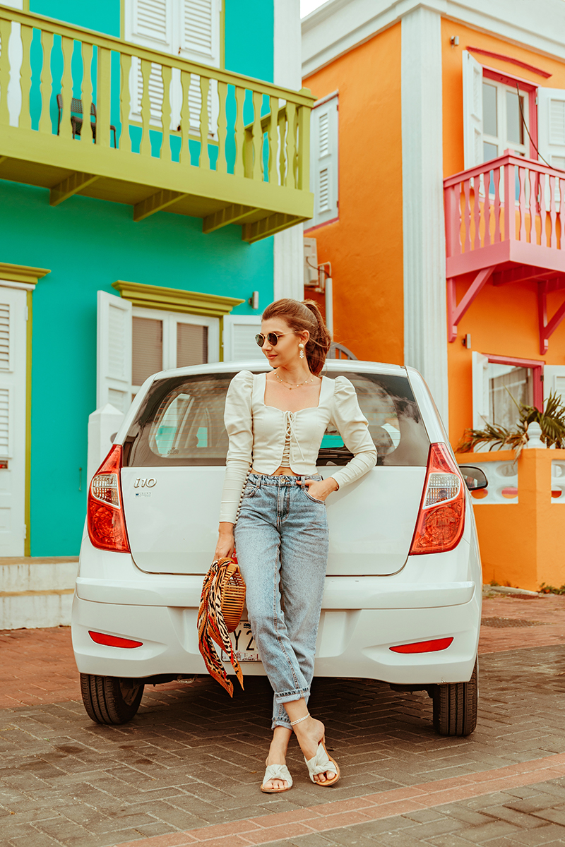 larisa costea, larisastyle, larisaincuracao, larisacosteablog, fashionblog, travel blog, travel, traveler, fashionbloggerincuracao, flamingolake, saltlake, curacao, willemstad, colourfulbuildings, netherlands, dutchantilles, antilles, caribbean sea,marea caraibelor, aruba, lacademie top,oversizedshoulders, duffy, puff sleeves, revolve,shopbop, soludos, slippers, bershkajeans,momjeans, mom jeans, cultgaia, strawbag, bamboobag, leopard print, leoprint, scarf, zara, rossrentalcars, ross, rental cars, curacao rent a car, best car rental, services, hynday, hyndayi10, i10, smallcar, colourful buildings, curacao bridge, white car, girl drives car, driver, curacaointernational airport, airport, carrental close to airport, raybansunnies, sunglasses, loverodin,pearl earrings, highpony,