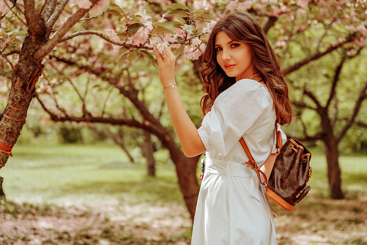 larisa costea, larisa costea blog, fashion blog, travel blog, lifestyle blog, white dress, cherry blossoms, blossom, cherry trees, pink blossoms, ootd, outfit inspiration, summer outfit, what to wear, summer dress, white dress, lpa dress, cotton dress, button up dress, midi dress, soft curls, beach waves, nude heels, kittem pumps, dianve von furstenberg, louis vuitton, backpack, monogram, vintage, cherry broche, cherries, georgeta dinca, handmade broche, rochie alba, tinuta de vara, ciresti infloriti, gradina japoneza, bucuresti, bucharest, herastrau, couple pic, couples photoshooting, love, nature, shopbop, shopbop sale, so bright, discount code, sales, big sales, designer items, designer shop, best price, adrian, adrian sunriseinc