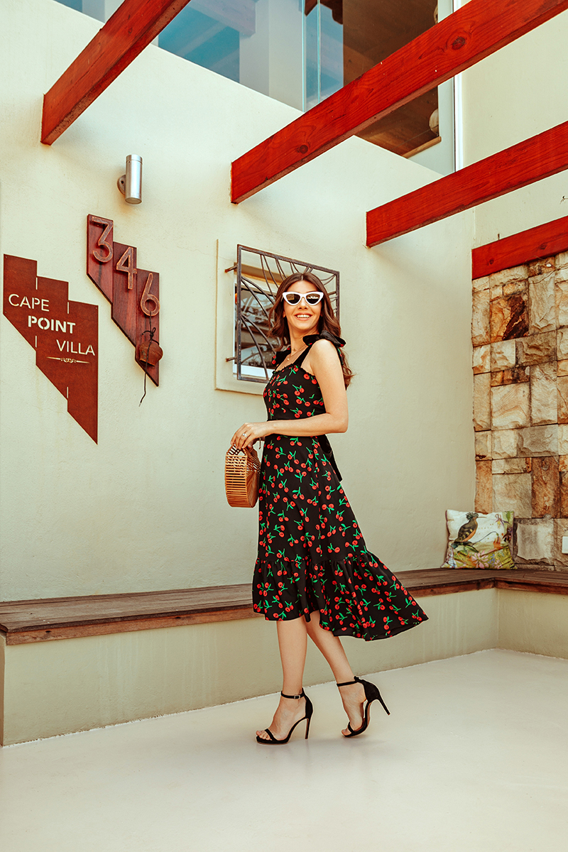larisa costea, larisa costea blog, fashion blogger, travel blogger, lifestyle blogger, cherry dress, cherry print, print cirese, print fructe, rochie cu print de fructe, la maison de confiance, showroom, dress, midi dress, black dress, ootd, outfit inspiration, holiday, vacation, south africa, za, scarborough, cape point villa, blouders beach, penguin beach, cape point, travel, best desitnation, best vacation, cult gaia bag, anna cori sandals, black sandals, villa, best hotels