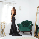 The black dress and the velvet chair