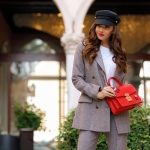 The plaid suit and the red bag